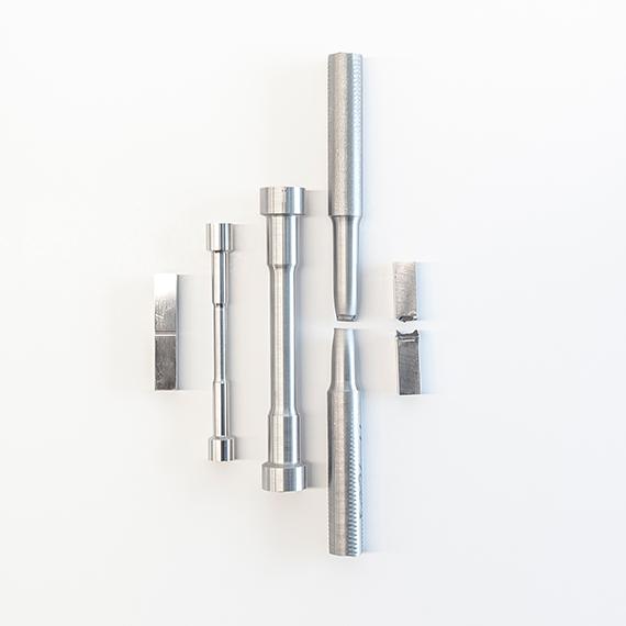Image of metal samples for metallurgical testing.