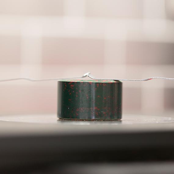 Image of metal sample used in metallurgical testing.
