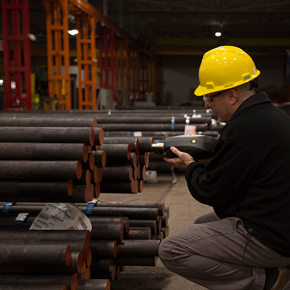 Image of man using equipment to perform on-site metal analysis.