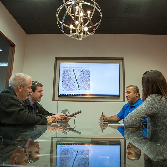 Image of staff consultation in Titan Metallurgy conference room.