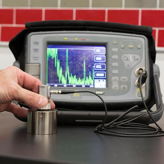 Image of equipment used for ultrasonic metal testing.